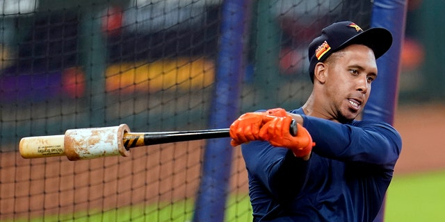 Houston Astros left fielder Michael Brantley warms up before taking batting practice during a baseball workout Wednesday, July 15, 2020, in Houston. (AP Photo/David J. Phillip)
