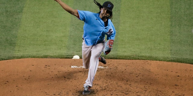 Miami Marlins' Jose Urena pitches during a baseball workout at Marlins Park, Thursday, July 16, 2020, in Miami. (AP Photo/Wilfredo Lee)