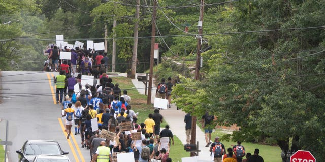 Dozens of protestors march to remove the monument led by the Atlanta chapter of NAACP. Source: Albert Fields / AlbertMultimedia.com