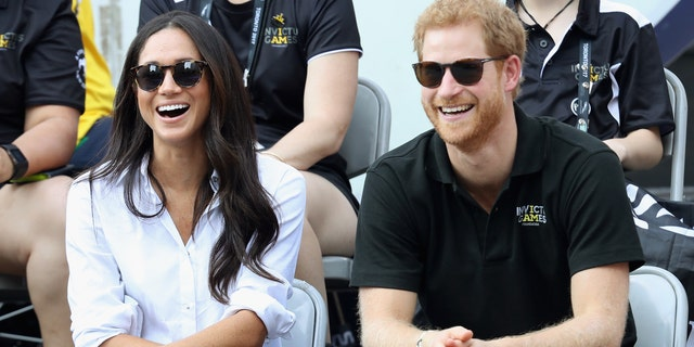 Meghan Markle (left) and Prince Harry at the Invictus Games in Toronto 2017. They were reported to have been secretly engaged at the time, according to a new book.  (Photo by Chris Jackson / Getty Images for the Invictus Games Foundation)