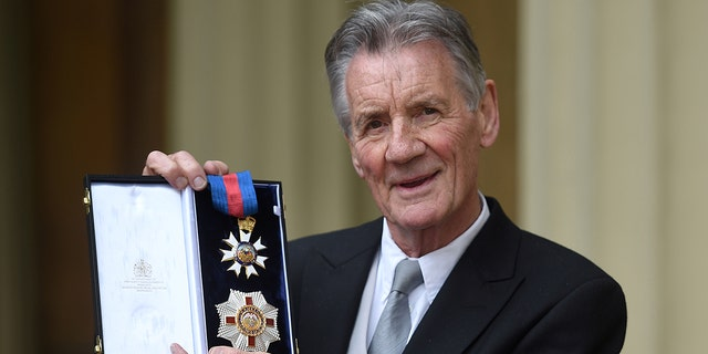 British actor and television presenter Michael Palin poses with his medals after being appointed a Knight Commander of the Order of St Michael and St George (KCMG) during an investiture ceremony at Buckingham Palace in London on June 12, 2019.