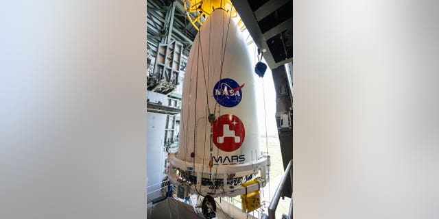 Métis - The nose cone containing NASA's Mars 2020 Perseverance rover is maneuvered into place atop its Atlas V rocket. The image was taken at Cape Canaveral Air Force Station in Florida on July 7, 2020.