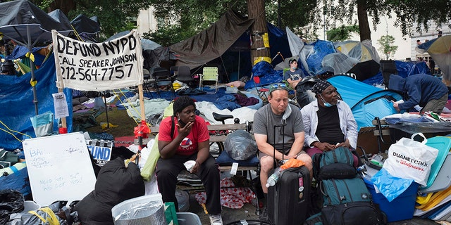 Protesters sit in their encampment, adjacent to City Hall. in New York, Wednesday, July 1, 2020. (AP Photo/Mark Lennihan)