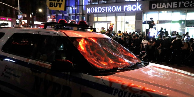 A police car with smashed wind shield is seen in Union Square during a demonstration in response to the death of a Minneapolis man George Floyd on May 29, 2020 in New York City.