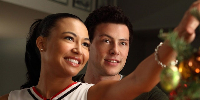 Santana (Naya Rivera, L) and Finn (Cory Monteith, R) spread some Christmas cheer in the 'A Very Glee Christmas' episode of 'GLEE.'