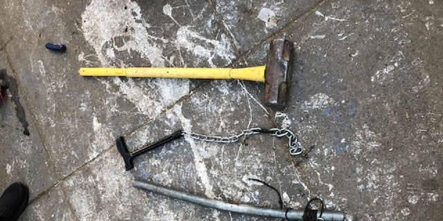 Several weapons, including a sledgehammer, pipe and a chain with a lock were found Thursday during the clean-up of a downtown <a data-cke-saved-href=