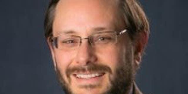 Zachary B. Smith is an associate professor of theology at Creighton University in Omaha, Nebraska.