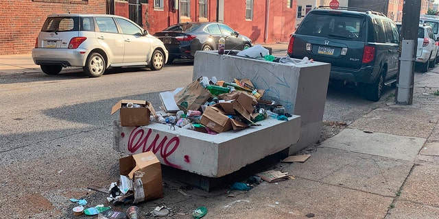 Trash rests piled up on a street Monday, July 27, 2020, in Philadelphia. The COVID-19 pandemic has frustrated efforts to keep Philadelphia's streets clear of garbage this summer. (Kara Kneidl via AP)