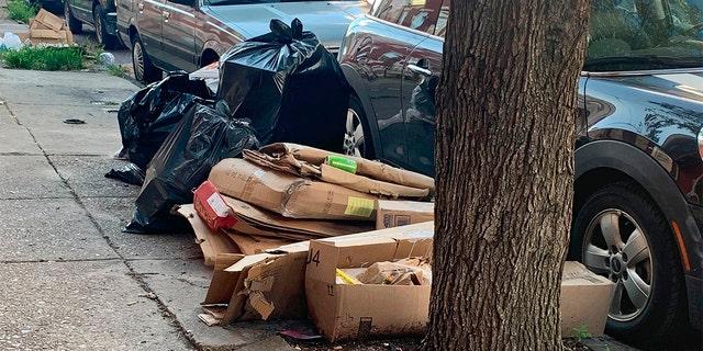 Trash rests piled up on a street Tuesday, July 28, 2020, in the Kensington neighborhood of Philadelphia. (Kara Kneidl via AP)