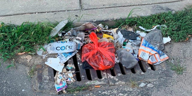 Trash rests on a street Tuesday, July 28, 2020, in Philadelphia. The COVID-19 pandemic has frustrated efforts to keep Philadelphia's streets clear of garbage this summer. (Kara Kneidl via AP)