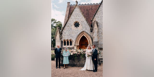 In this photograph released by the Royal Communications of Princess Beatrice and Edoardo Mapelli Mozzi, Britain's Queen Elizabeth II and Prince Philip stand alongside Princess Beatrice and Edoardo Mapelli Mozzi outside The Royal Chapel of All Saints at Royal Lodge, Windsor, England, after their wedding.
