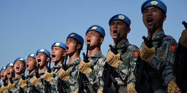 Chinese troops take part in marching drills ahead of an October 1 military parade to celebrate the 70th anniversary of the founding of the People's Republic of China at a camp on the outskirts of Beijing.