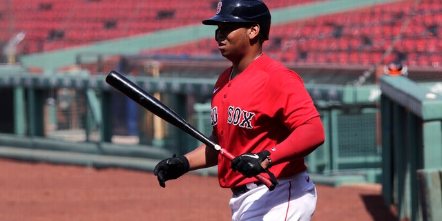 Boston Red Sox's Rafael Devers heads to the plate for an at-bat during an intra-squad game at Fenway Park on Thursday, July 9, 2020, in Boston. (AP Photo/Charles Krupa)