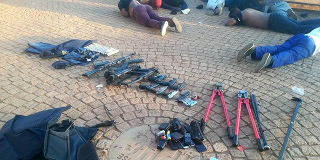 South African police seized weapons and made more than 40 arrests after responding to a hostage situation at International Pentcost Holiness Church, Zuurbekom, overnight Saturday.