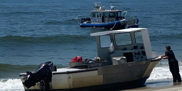 The stolen boat was found stuck on a nearby beach, police say. (Suffolk County Police Department)