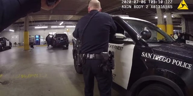 A man was shot at San Diego police headquarters Sunday after he slipped off his handcuffs, grabbed an officer's gun from a backpack inside a police SUV and fired, police said.