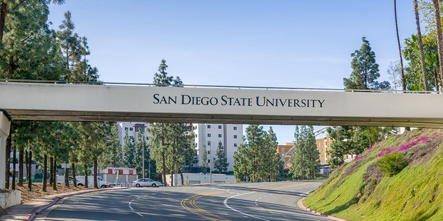 An entrance sign and bridge to San Diego State University.