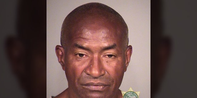 Police got 911 calls that Shane Vordelmicha Green had assaulted people with the handsaw and a belt, broken car windshields and threatened people. (Portland Police)