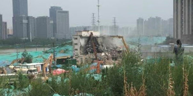 The demolition of Sunzhuang Church on June 12.
