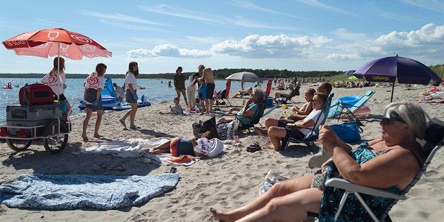 People gather on a beach on July 17, 2020 in Gotland, Sweden. (Martin von Krogh/Getty Images)