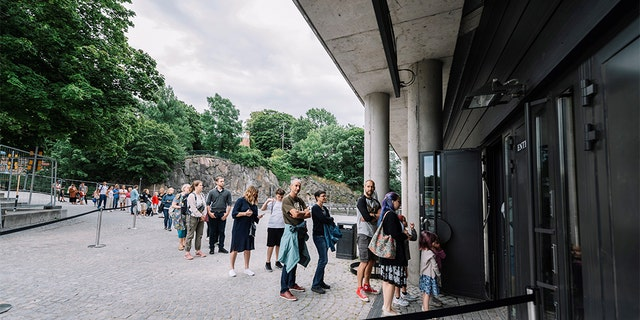 People queue to visit the Vasa Museum in Stockholm on July 15, 2020 on the day of its reopening amid the new coronavirus pandemic. (STINA STJERNKVIST/TT News Agency/AFP via Getty Images)