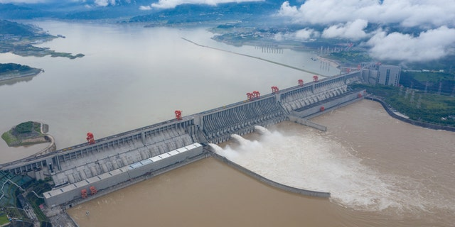 The Three Gorges dam is discharging flood. Yichang City, Hubei Province, China, July 2. The dam has come under new scrutiny after devastating flooding over the past few weeks.