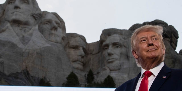 Former President Donald Trump smiles at Mount Rushmore National Memorial, Friday, July 3, 2020, near Keystone, S.D. (Associated Press)