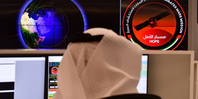 An employee working at the control room of the Mars Mission at the Mohammed Bin Rashid Space Centre (MBRSC), in the Gulf emirate of Dubai.