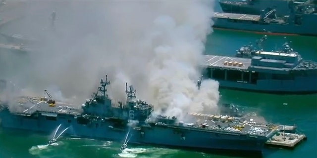 This screenshot provided by KGTV-TV in San Diego shows the USS Bonhomme Richard at Naval Base San Diego Sunday, July 12, 2020, in San Diego after an explosion and fire Sunday on board the ship at Naval Base San Diego. (KGTV-TV via AP)