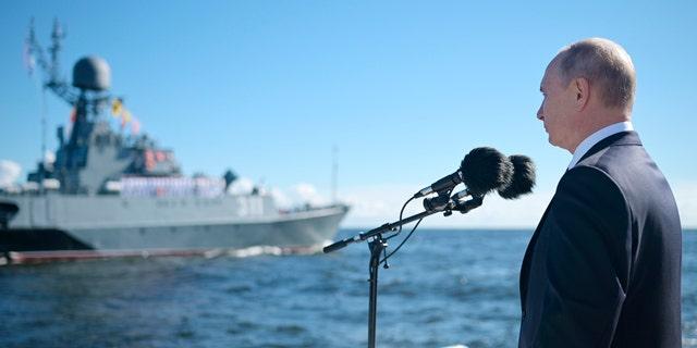 President Vladimir Putin inspects warships during the Navy Day parade in St.Petersburg, Russia, on Sunday, July 26, 2020. (Alexei Druzhinin, Sputnik, Kremlin Pool Photo via AP)