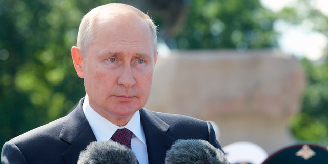President Vladimir Putin attends the Navy Day parade in St.Petersburg, Russia, on Sunday, July 26, 2020. (Alexei Druzhinin, Sputnik, Kremlin Pool Photo via AP)