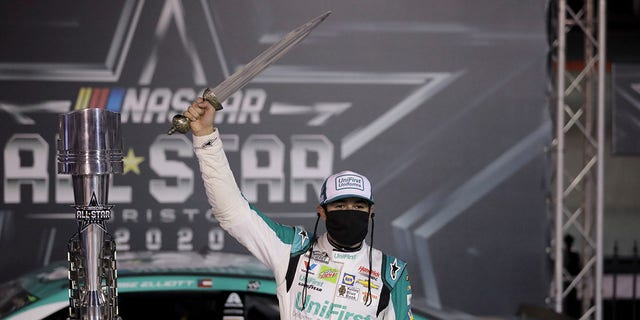 "Elliott holding the sword winners get at Bristol, which bills itself as ""The Last Great Colosseum."""