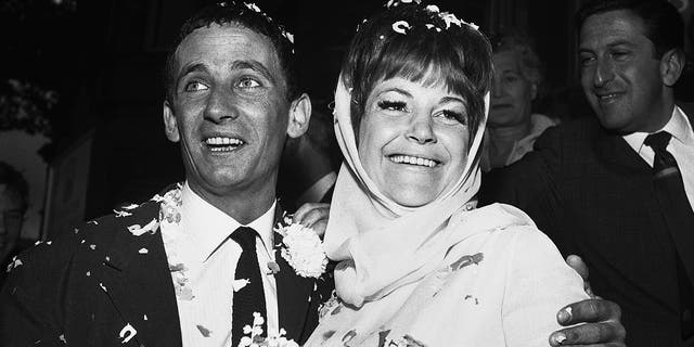In this Aug. 19, 1963, file photo, British jazz singer Annie Ross, right, and actor Sean Lynch are covered with confetti after their marriage in London. Ross, who rose to fame as a jazz singer in the 1950s, struggled with personal problems in the '60s, faded from the spotlight in the '70s, re-emerged as a successful character actress in the '80s and finished her career as a cabaret mainstay, died on July 21 at her home in New York.
