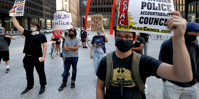 Protesters gather on Federal Plaza on Thursday after a collection of Chicago groups announced a federal lawsuit against the Chicago Police Department and others to prevent agents from making arrests or detaining people without probable cause. (AP Photo/Charles Rex Arbogast)