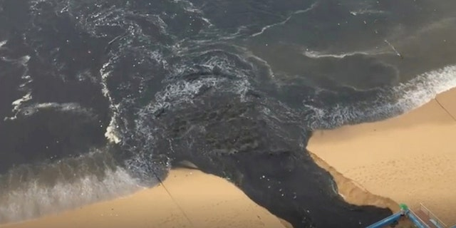 """""""Black water"""" flows into Acapulco Bay in Acapulco, Guerrero, Mexico June 25, in this picture obtained from social media. Picture taken June 25."""