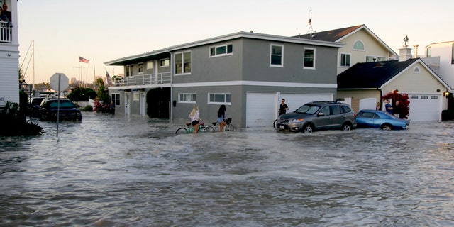 Streets in the Balboa Peninsula are flooded by coastal tides and high surf in Newport Beach, Calif., July 3.