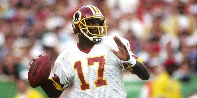 Quarterback Doug Williams #10 of the Washington Redskins drops back to pass during Super Bowl XXII against the Denver Broncos at Jack Murphy Stadium on January 31, 1988 in San Diego, California. The Redskins won 42-10. (Photo by George Rose/Getty Images)