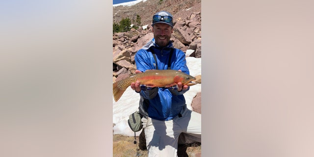 Kendall Johnson and his record golden trout.