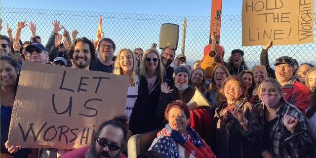 A group of Christian gathered at the Golden Gate Bridge in San Francisco to protest in worship the state's ban on singing in churches citing a surge in COVID-19 cases.