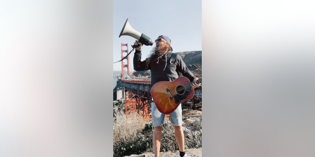 Sean Feucht, Hold The Line founder, leads worship at the Golden Gate Bridge on Thursday, July 9, 2020. Between 300 and 400 gathered to protest the state's ban on singing in churches due to a surge in coronavirus cases, organizers said.