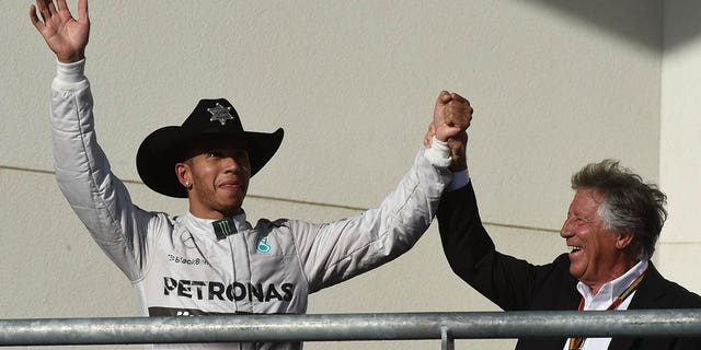 Andretti celebrated with Hamilton after the British driver's win at the United States Formula One Grand Prix in 2014.