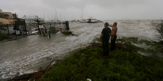 Boat owners examine the damage after the docks at the marina where their boats had been secured were destroyed as Hurricane Hanna made landfall, Saturday, July 25, 2020, in Corpus Christi, Texas.