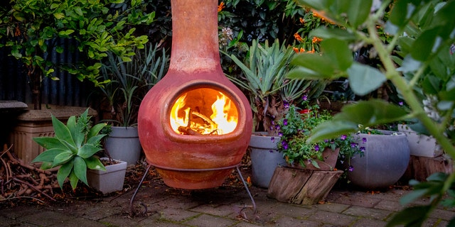 The classic chiminea, the Spanish word for chimney, burns by design like a fireplace.