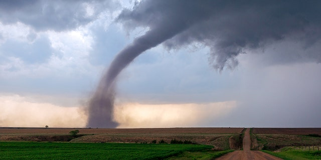 If that funnel cloud makes contact with the ground or has a debris cloud or dust whirl beneath it, then it's classified as a tornado.