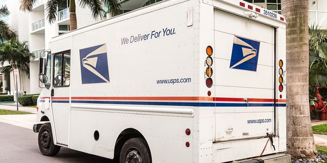 A United States Post Office mail truck (USPS) parked in Miami, Florida