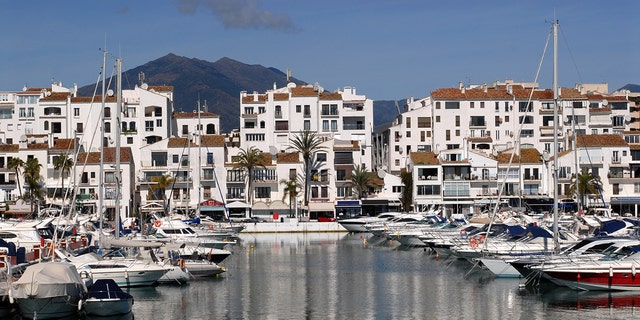 Two men have died in Spain after a British tourist fell from a balcony at a hotel and landed on another man below, according to officials.