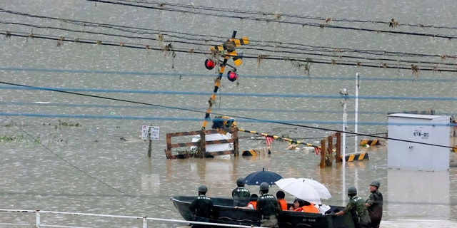 Heavy rain in the Kumamoto region triggered flooding and mudslides Saturday and left dozens still being stranded at their homes and other facilities.