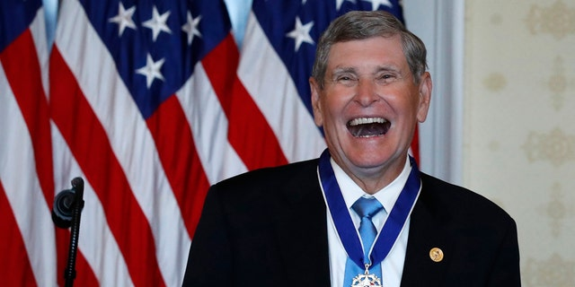 Jim Ryun reacts after President Donald Trump presented the Presidential Medal of Freedom to Ryun, in the Blue Room of the White House, Friday, July 24, 2020, in Washington. (AP Photo/Alex Brandon)