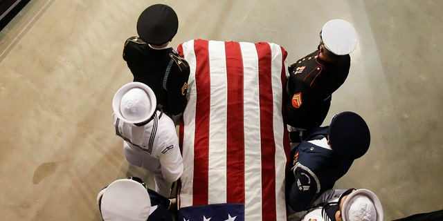 The casket of the late Rep. John Lewis, D-Ga., arrives to lie in repose at Troy University on Saturday, July 25, 2020, in Troy, Ala. (AP Photo/Brynn Anderson)