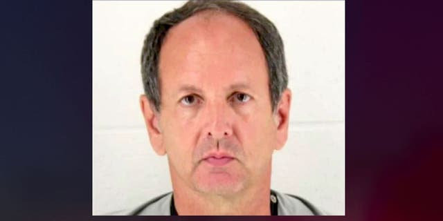 James Loganbill, 58, left his teaching job in March. He now faces a charge of reckless stalking, authorities say. (City of Olathe)